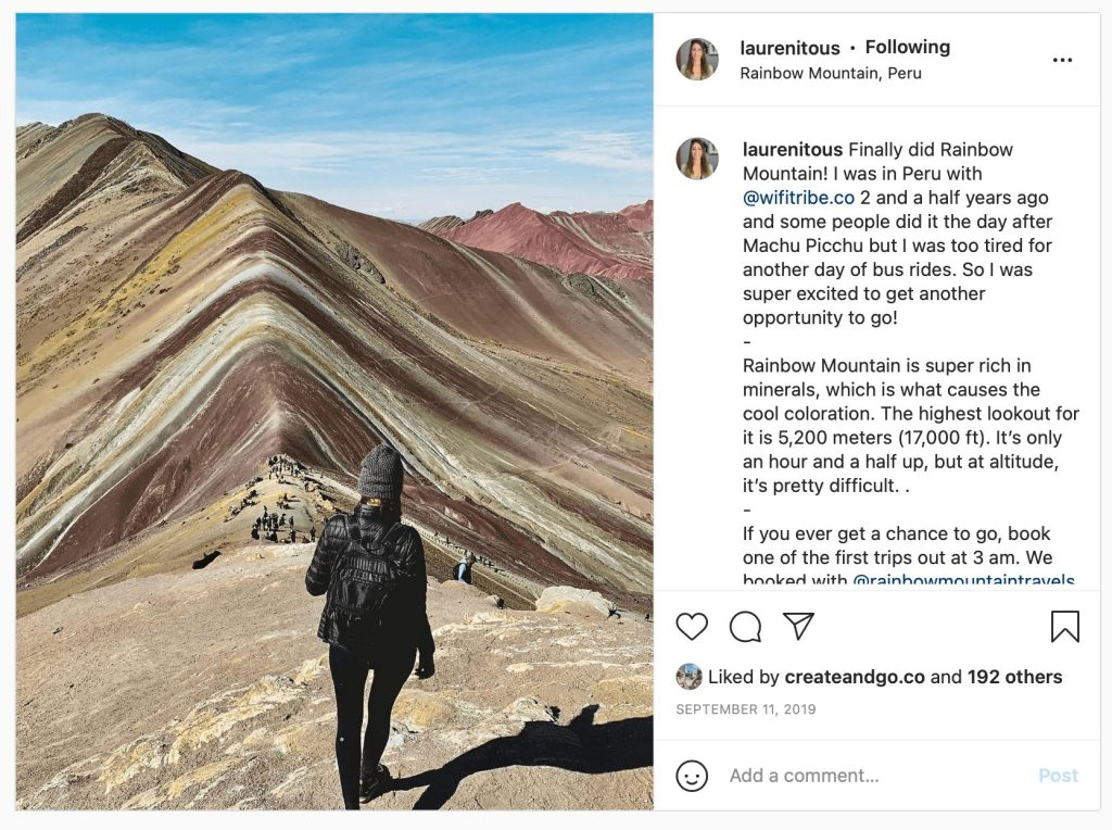 Lauren on Rainbow Mountain in Peru, with her back facing the camera.